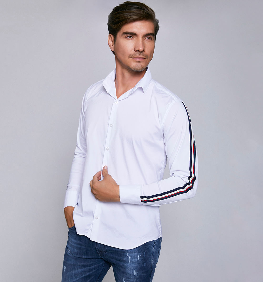 542835aa4 Camisa manga larga unicolor con adorno d